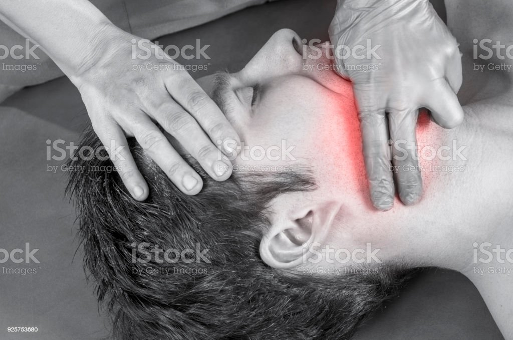 Physiotherapist, chiropractor is doing intraoral technique of massage masseter muscle. Osteopathy. stock photo