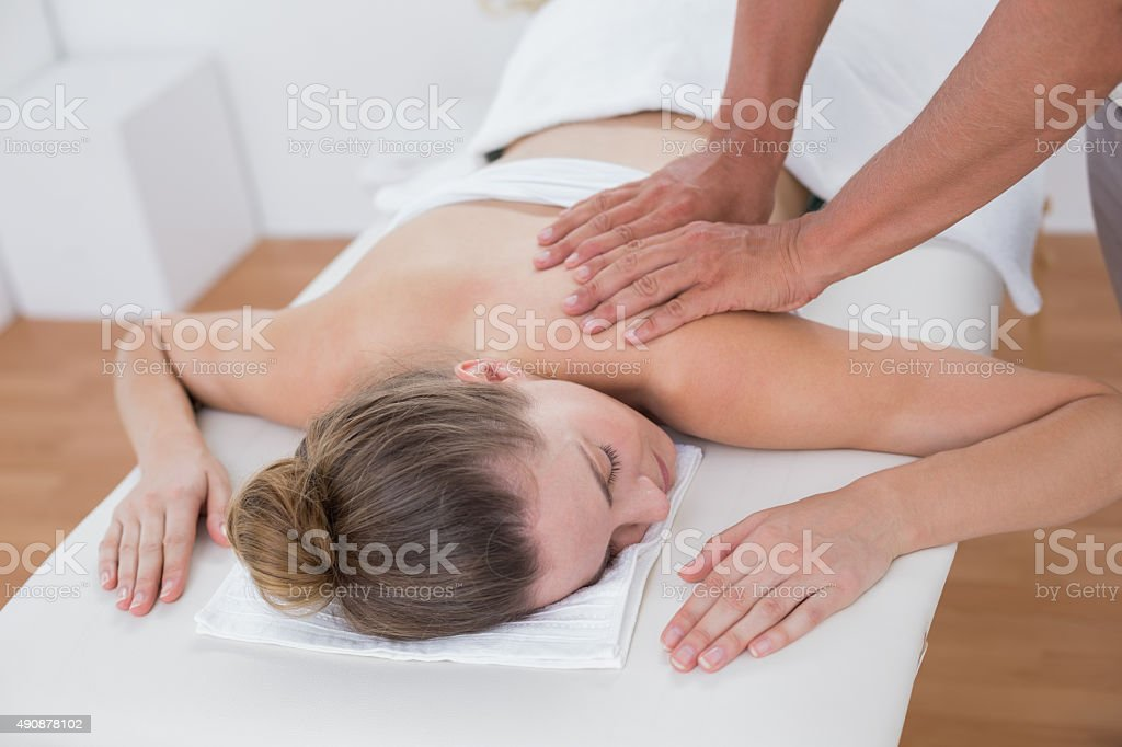 Physiotherapist doing arm massage to his patient stock photo