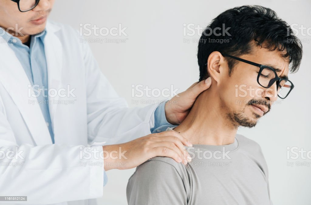 Physiotherapist doing healing treatment on man\'s neck,Chiropractic...