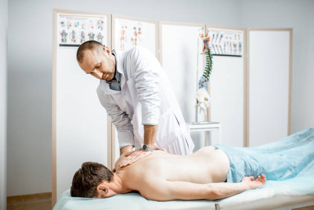 physiotherapist doing manual treatment - osteopathy stock pictures, royalty-free photos & images