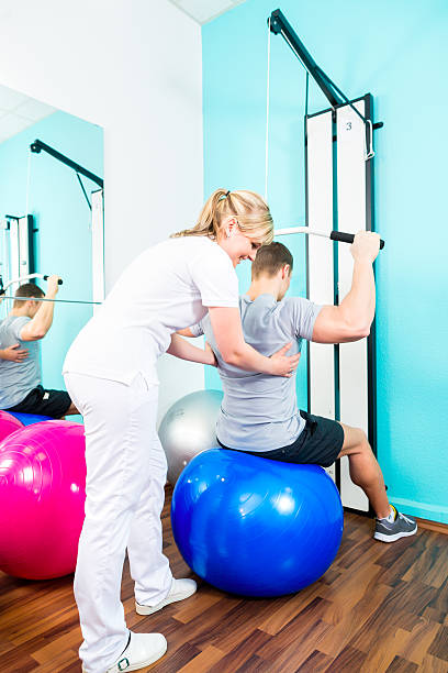 Physiotherapist doing sport rehabilitation with patient stock photo