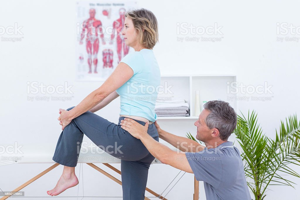 Physiotherapist examining his patient back stock photo