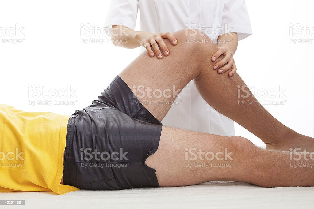 Physiotherapist massaging a leg stock photo