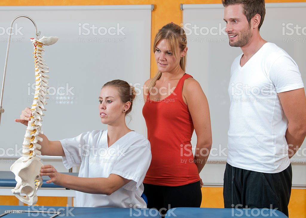 physiotherapist teaching stock photo