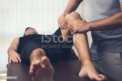 istock Physiotherapist treating athlete male patient 1136060797