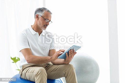 istock Physiotherapist using digital tablet 840830422