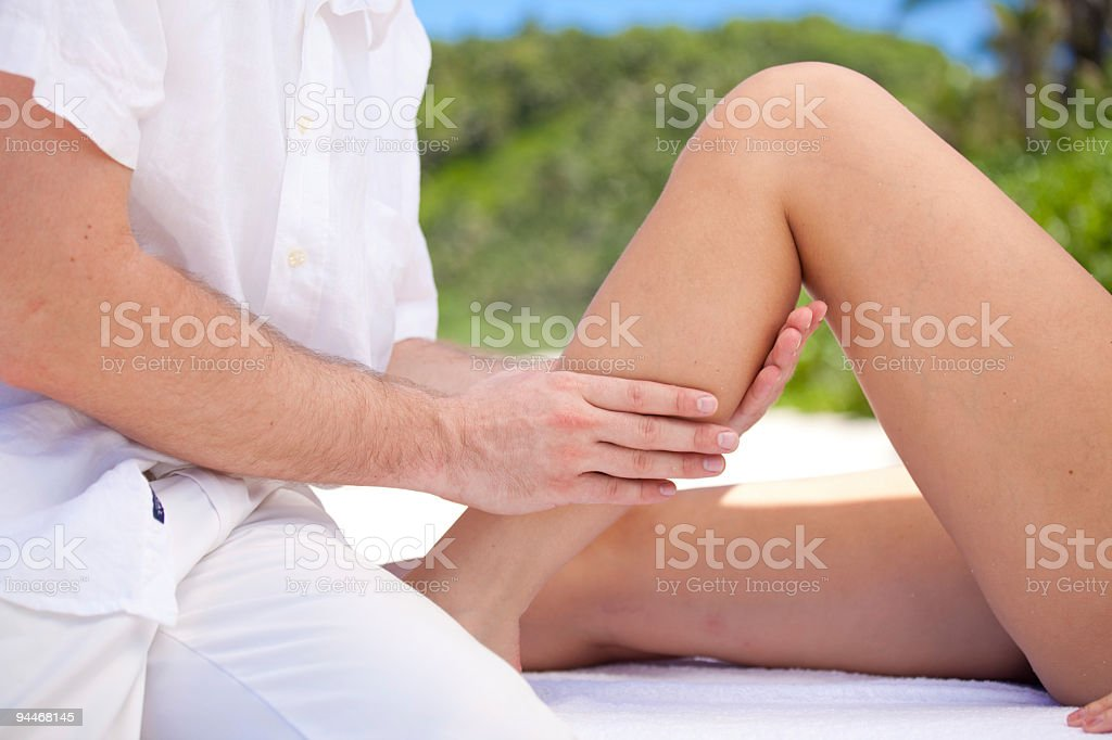 physiotherapist working on womans lower leg royalty-free stock photo