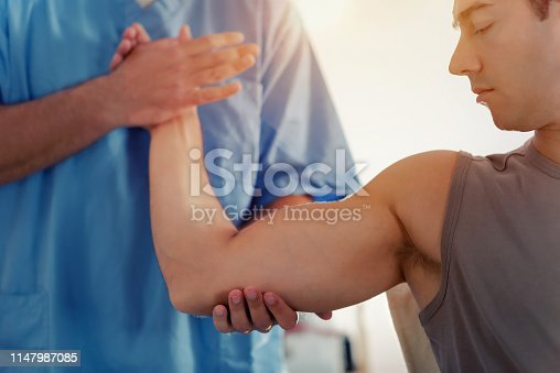 istock Physiotherapist Working With Patient Arm 1147987085