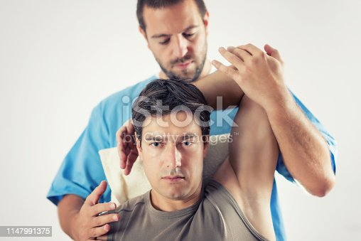 istock Physiotherapist Working With Patient Arm 1147991375