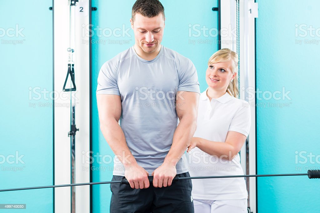 Physiotherapist working with patient in practice stock photo