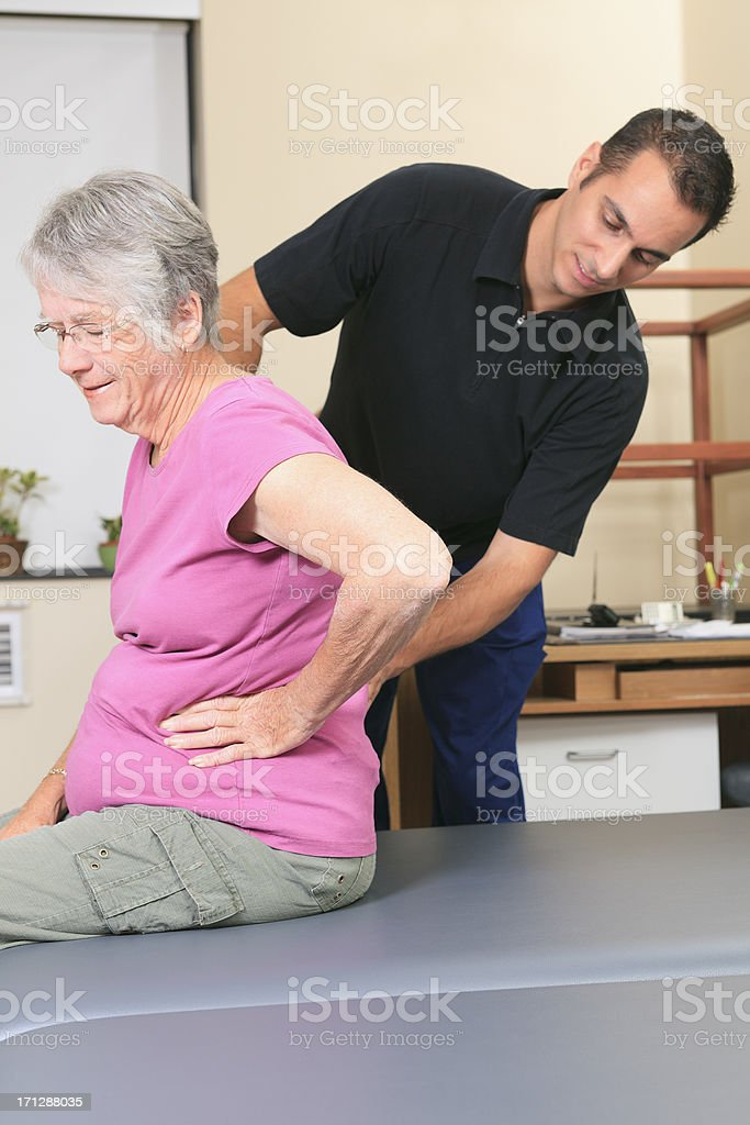 Physiotherapy - Check Back Vertical stock photo