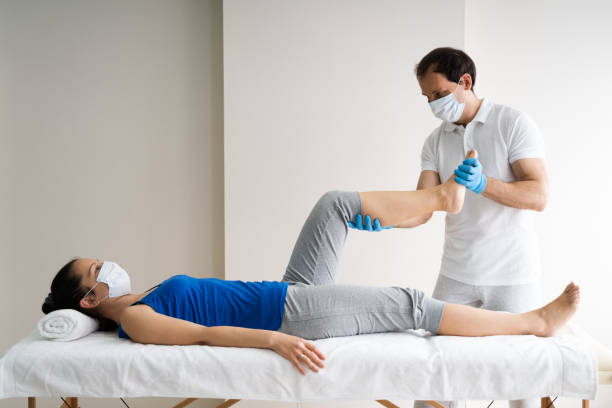 Physiotherapy Knee Injury Rehab And Massage stock photo