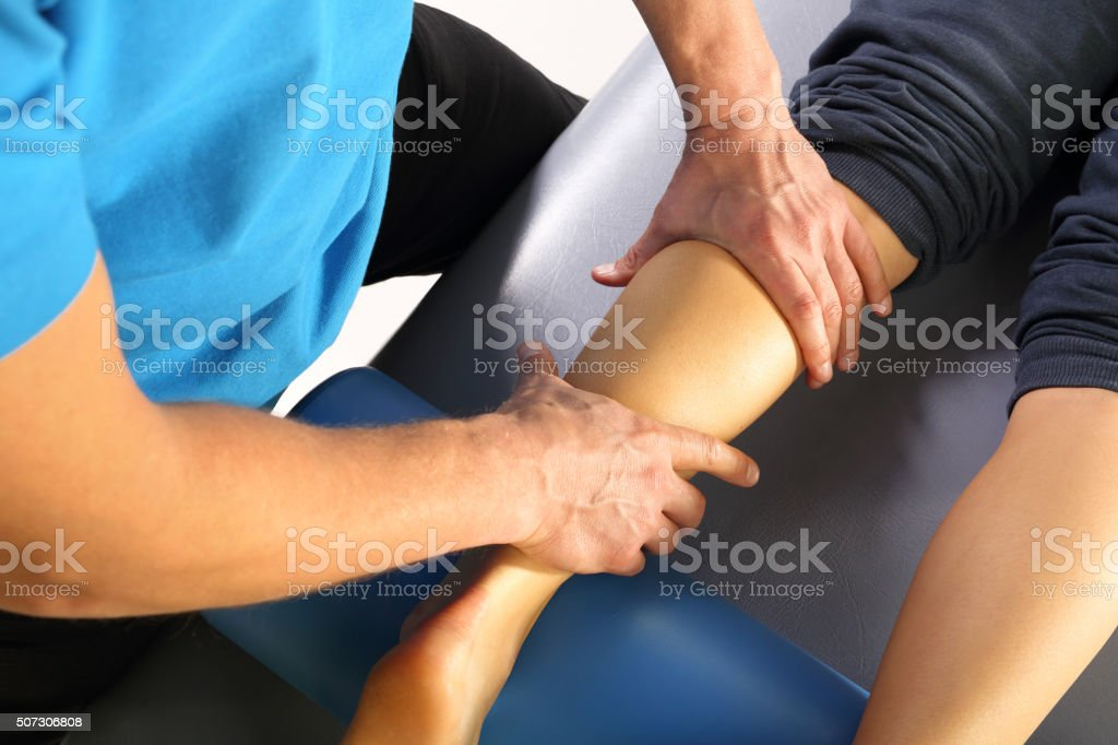 Physiotherapy, Massage legs stock photo