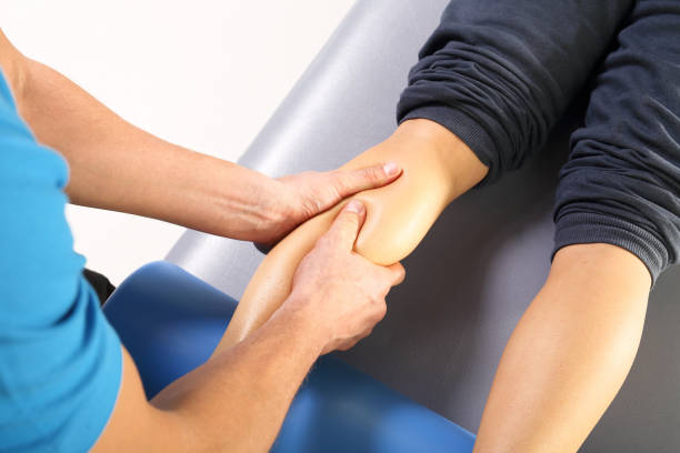 physiotherapy, massage legs - contributor stock pictures, royalty-free photos & images