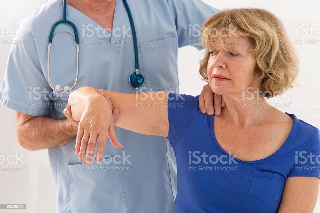 Physiotherapy Senior  woman and physiotherapist stock photo