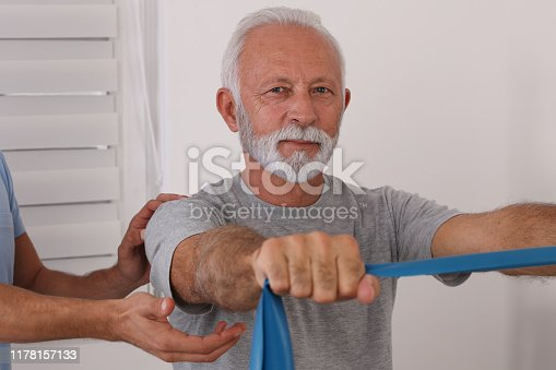 885281276istockphoto Physiotherapy, Sport Injury rehabilitation of senior male patient. Kinesiology treatment 1178157133
