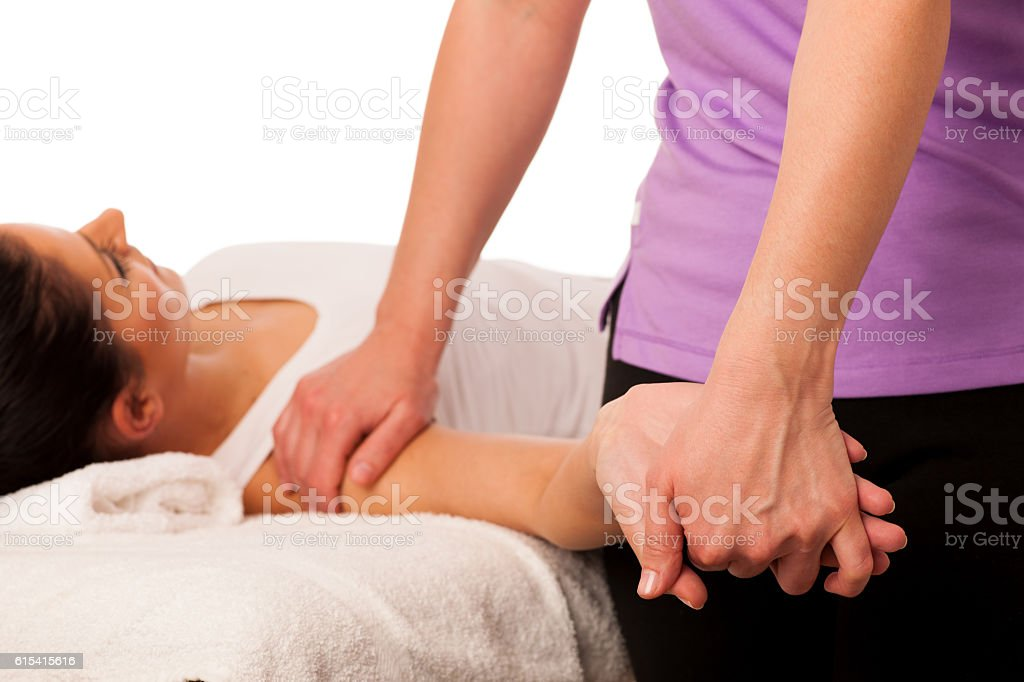 physiotherapy -therapist excercising with patient stock photo