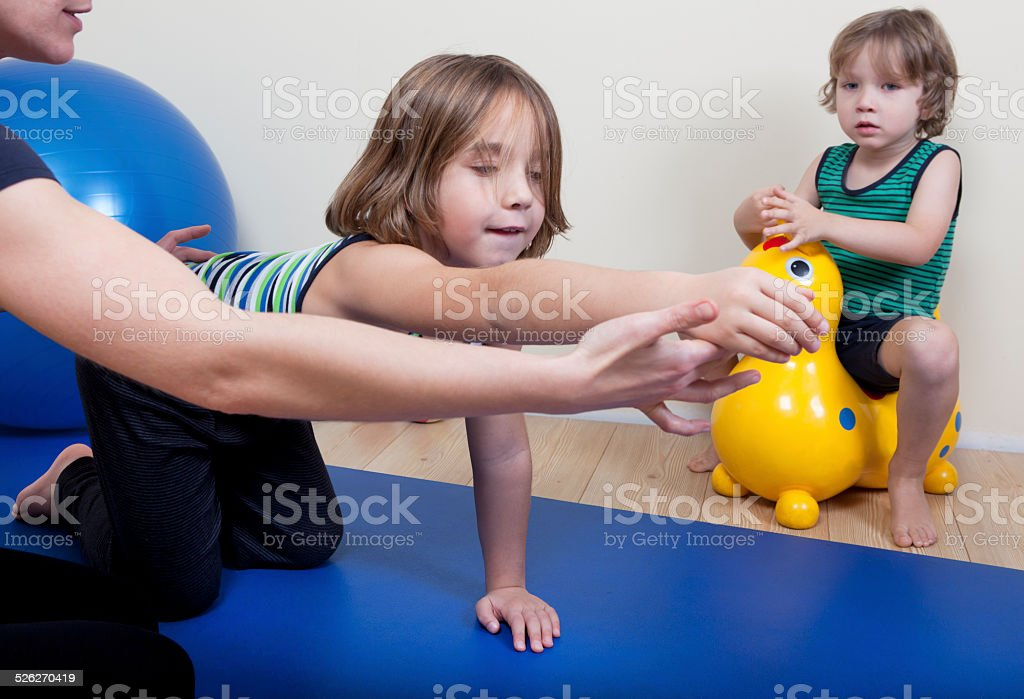 Physiotherapy with two children stock photo