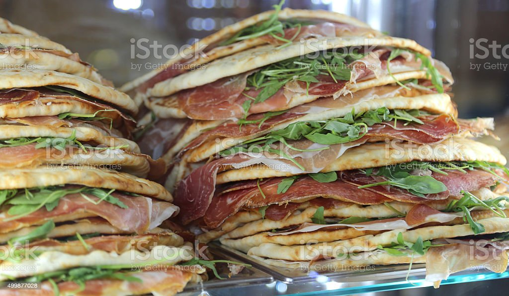 piadina stuffed for sale in the restaurant in central Italy stock photo
