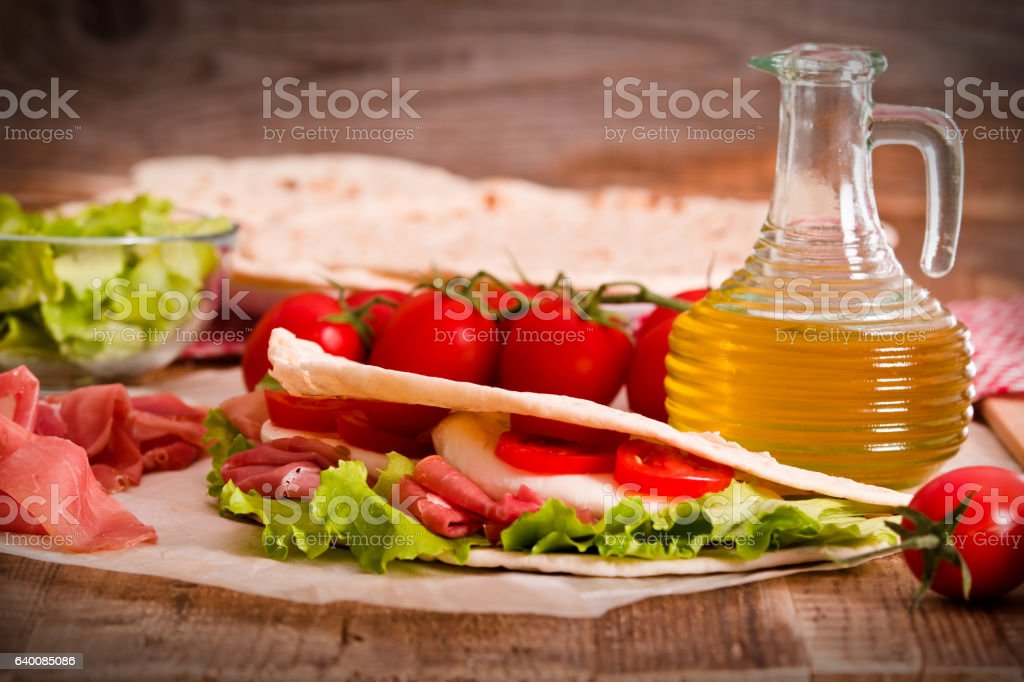 Piadina with ham and lettuce. stock photo