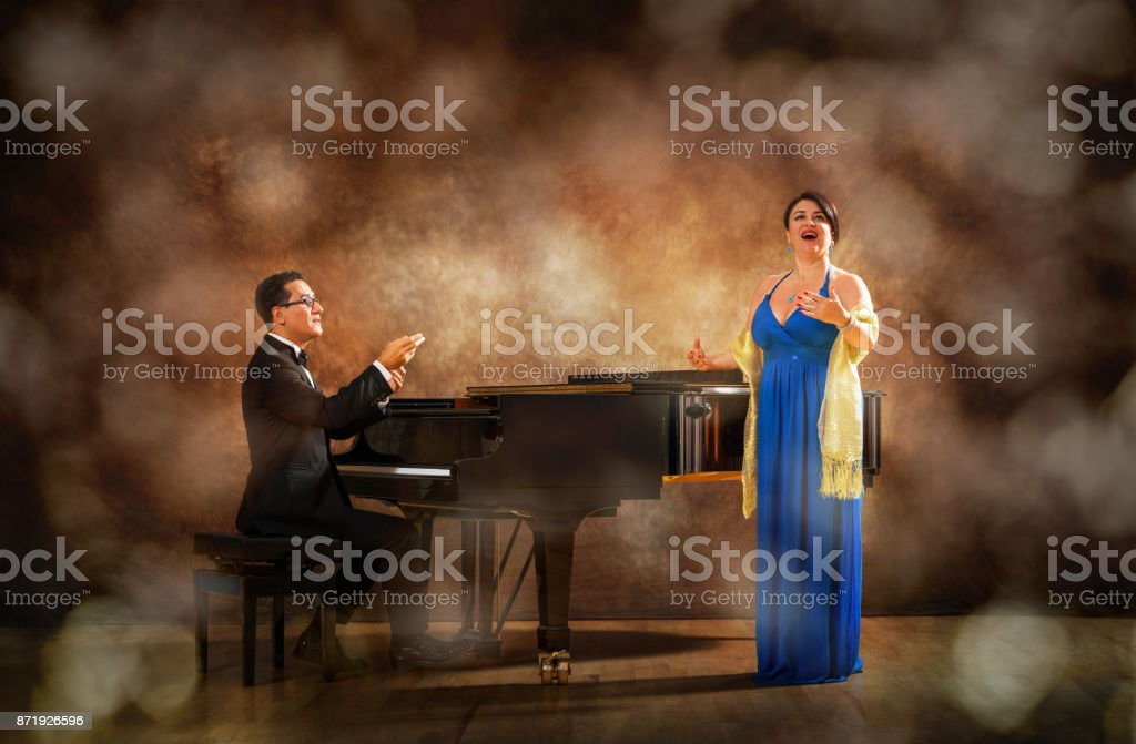 Pianist and singer during stage performance stock photo