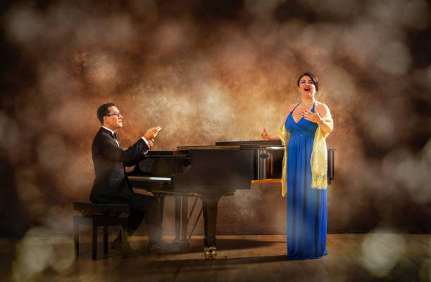 pianist and singer during stage performance - opera stock photos and pictures