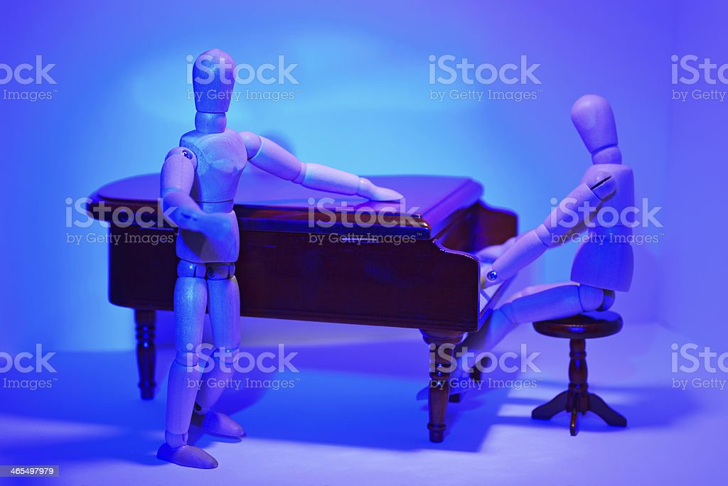 Pianist and singer in the blue stage light. royalty-free stock photo