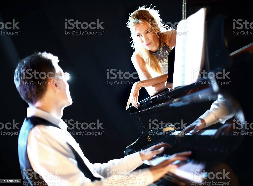 Pianist and singer. stock photo