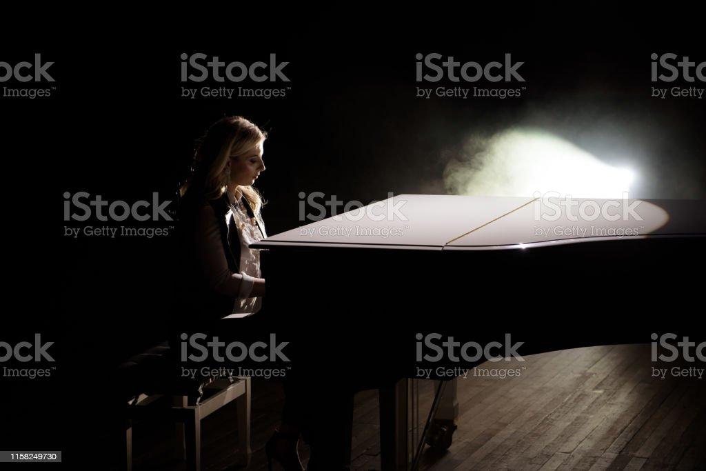 Pianist musician piano music playing. Musical instrument grand piano...