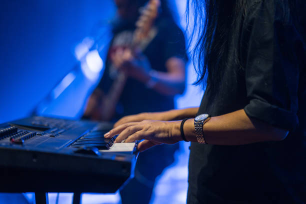 Pianist playing electric piano in concert at night, music concept. Pianist playing electric piano in concert at night, music concept. keyboard player stock pictures, royalty-free photos & images