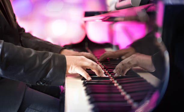 Pianist Playing Grand Piano Jazz Or Blues Music Background pianist stock pictures, royalty-free photos & images