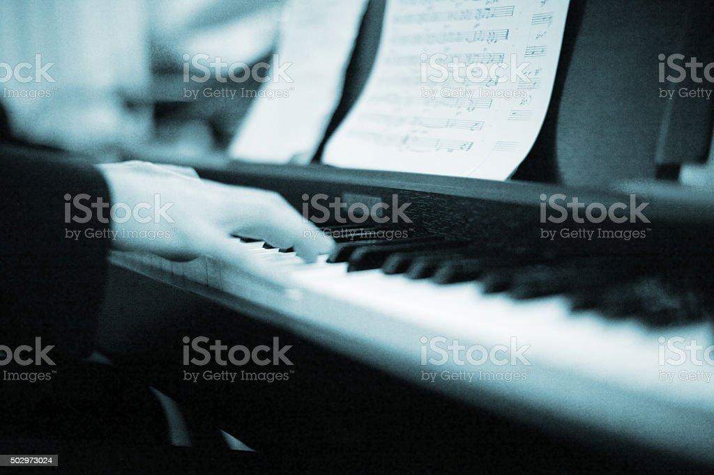 Pianist playing piano sheet music stock photo