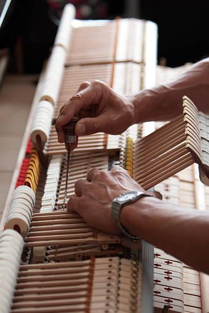 Piano adjustments stock photo