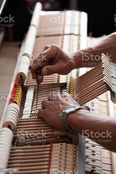 Piano Adjustments Stock Photo - Download Image Now