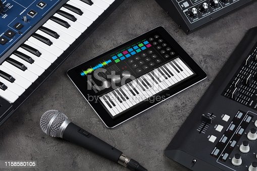 istock Piano app on tablet and musical instrument concept 1158580105