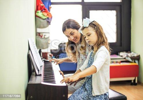 Piano class. Child in music school with teacher.