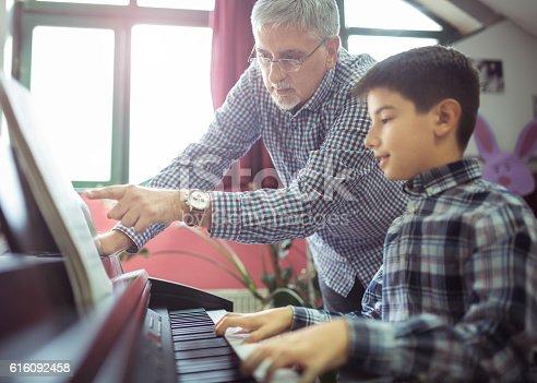 istock Piano class 616092458