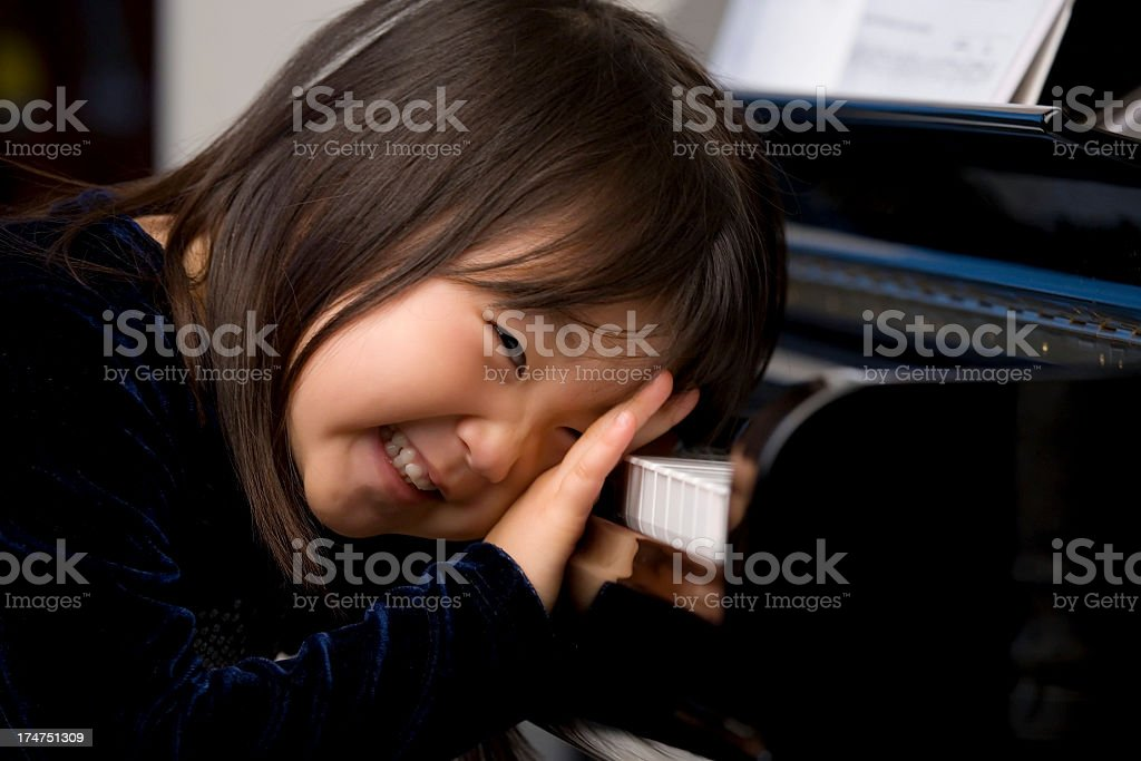 Piano girl royalty-free stock photo