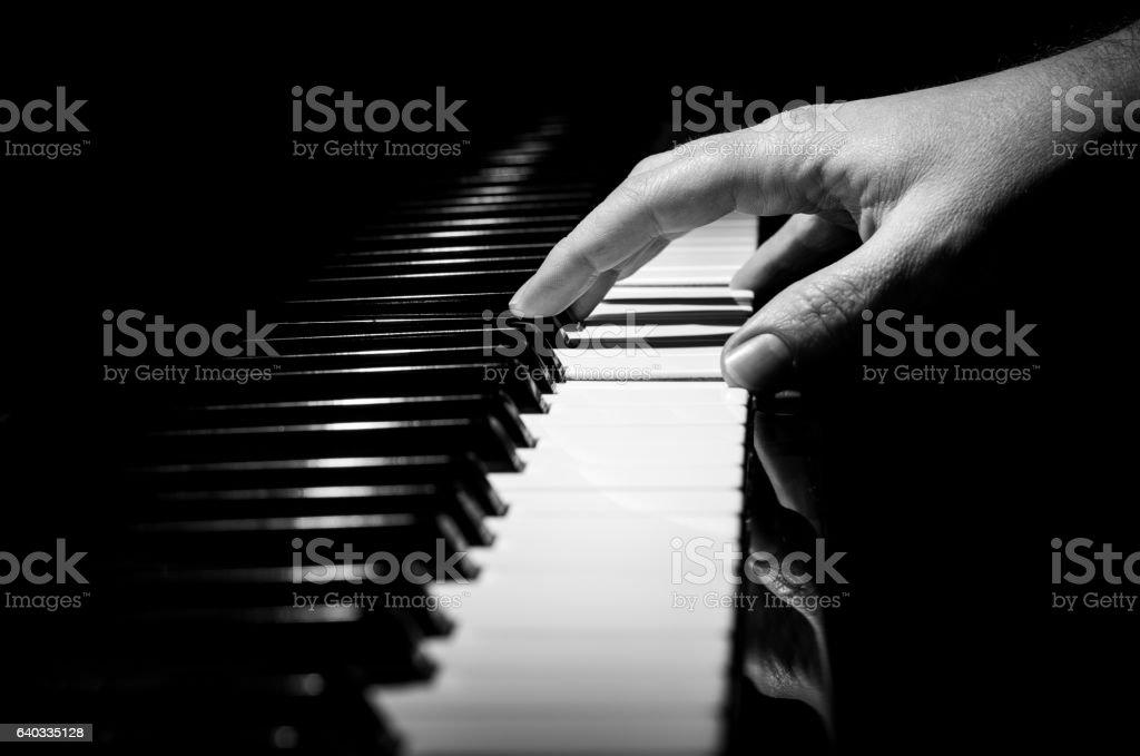 piano horizontal black and white hand stock photo