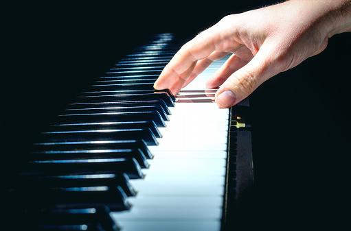 piano horizontal hand colour blue