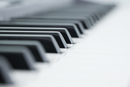Piano is a musical instrument classified as a percussion instrument that is played by pressing keys on a keyboard.