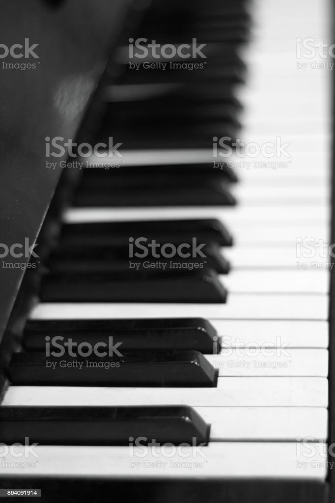 Piano keyboard background with selective focus. Black and white color image . royalty-free stock photo