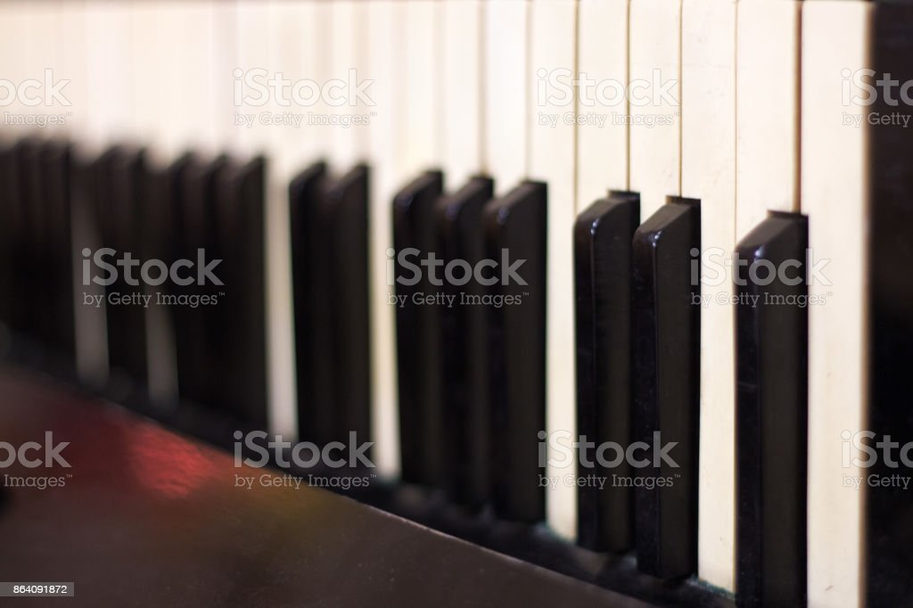 Piano keyboard background with selective focus. royalty-free stock photo
