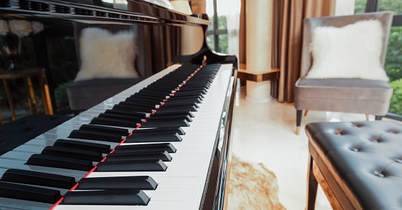 piano keyboard in music living room at modern luxury house, selective focus