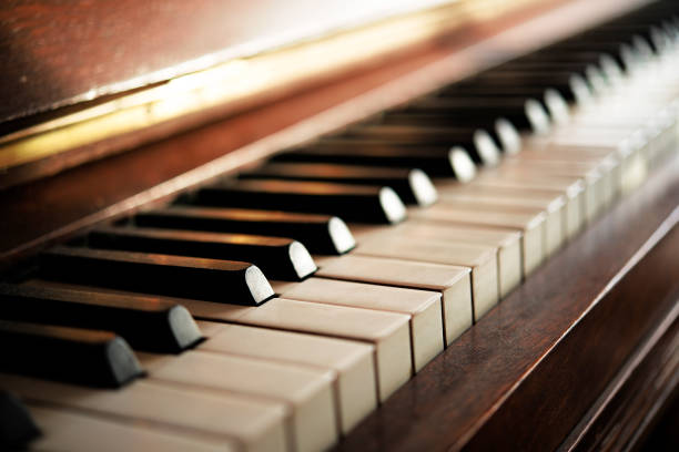 piano keyboard of an old music instrument, close up - piano imagens e fotografias de stock