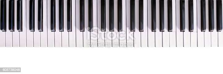 Old piano keyboard isolated on white