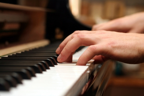 piano / keyboard playing hands and finger