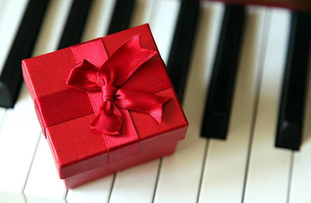 Piano Keys and Gift stock photo