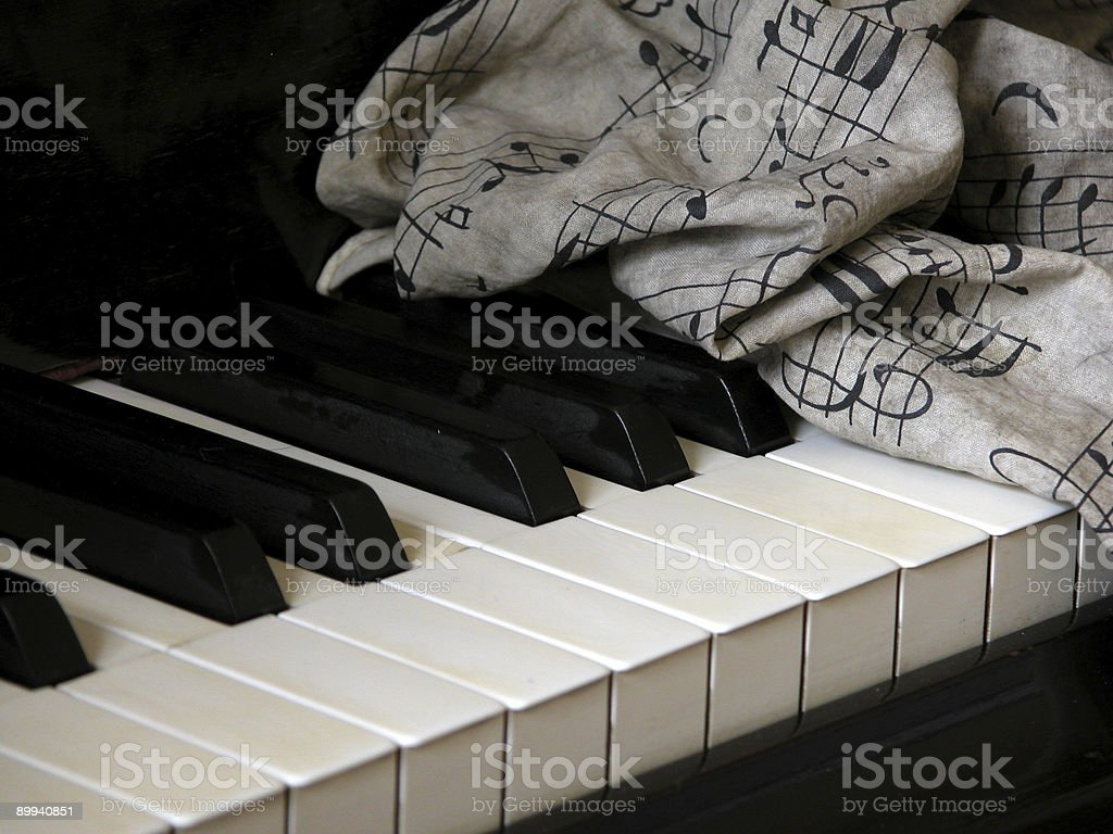 Piano Keys and scrunched notes stock photo