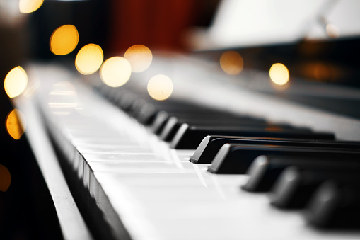 piano keys bokeh in the background Christmas lights